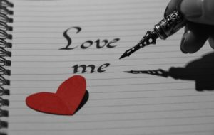 "Calligraphy pen writing ""love me"""
